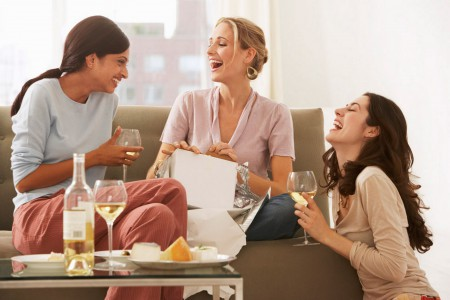 Women drinking wine and laughing-1587590